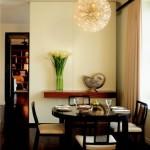 Ambiente de jantar mais íntimo com parede divisória