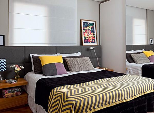 quarto com cama encostada na janela 1