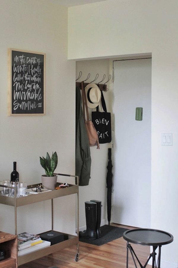 Entrada de apartamento com barzinho
