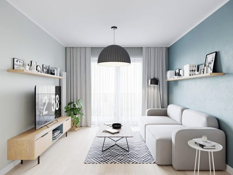 sala de estar tranquila em cores neutras e azul sofá cinza