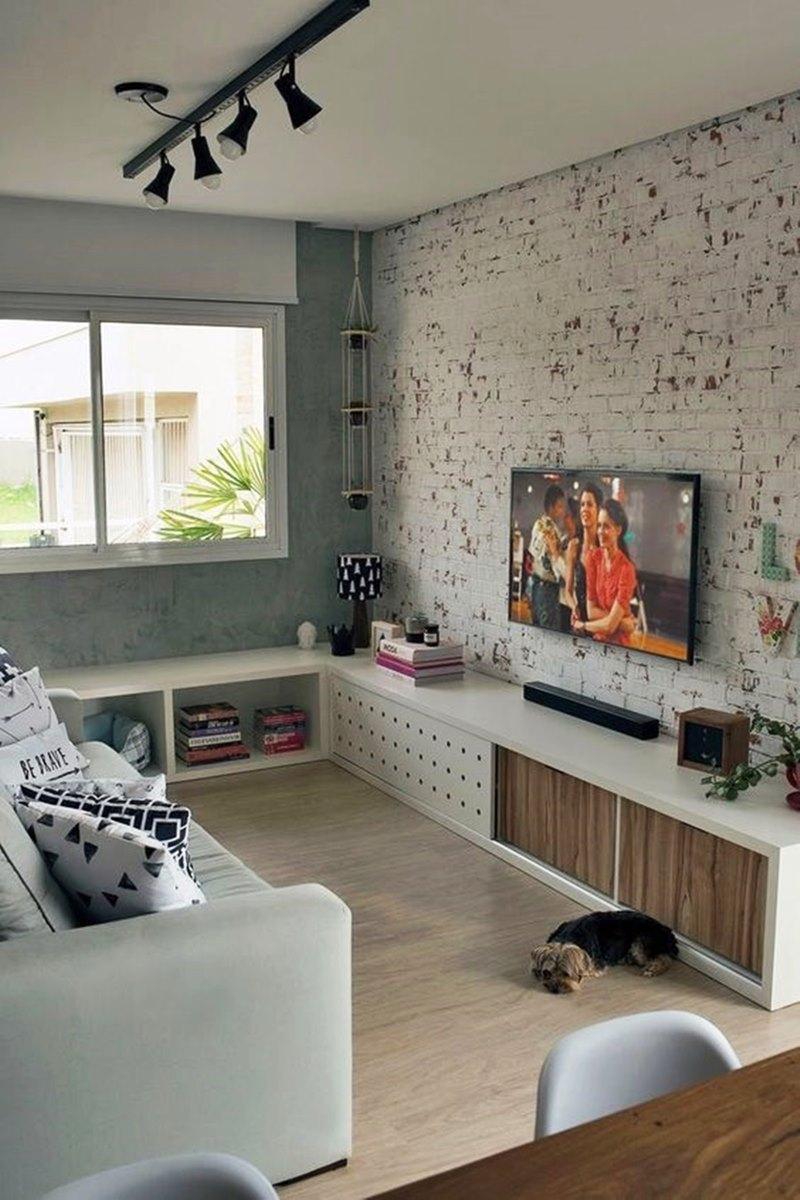 Sala pequena com tijolinho branco