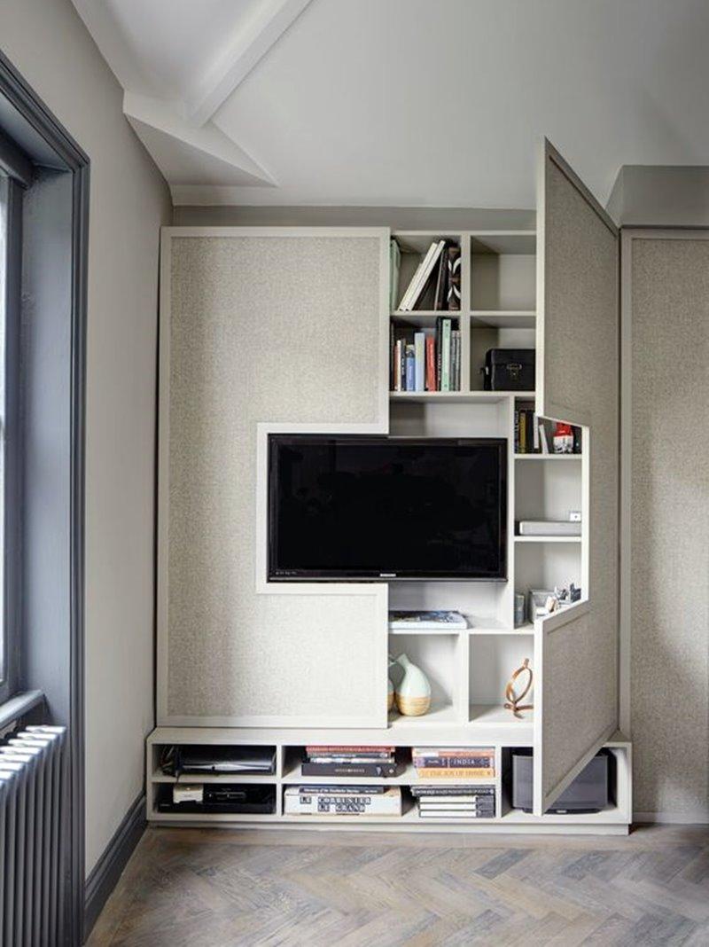 Painel de tv com estante de livros embutida